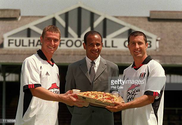 Fulham manager Jean Tigana with players Lee Clark and John Collins at the Press Conference to announce a major new sponsorship deal between Fulham...