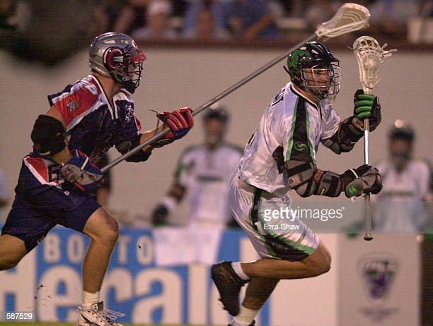 Gary Gait of the Long Island Lizards fights for the ball with Ryan Curtis of the Boston Cannons during their game at Cawley Stadium in Hudson...