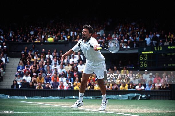 Goran Ivanisevic of Croatia in action against Patrick Rafter of Australia during the Men's Final of The All England Lawn Tennis Championship at...