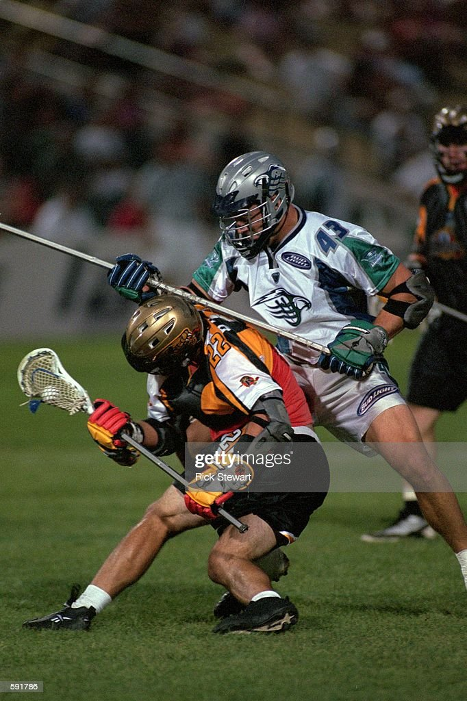 Hugh Donovan of the Baltimore Bayhawks trying to block Ryan Powell during the game against the Rochester Rattlers at Frontier Field in Rochester New...