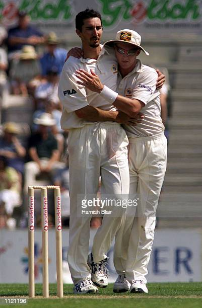 Jason Gillespie of Australia is congratulated by team mate Brett Lee after taking the wicket of Lawrence Prittipaul of Hampshire caught by Wade...