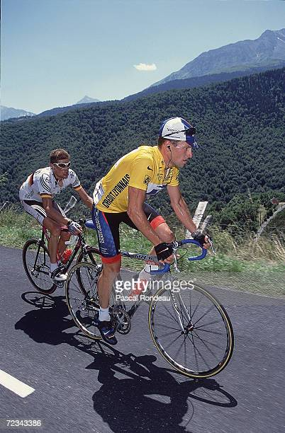 Lance Armstrong of the USA in the Yellow Jersey and riding for the US Postal team is shadowed by Jan Ullrich of Germany during Stage 14 from Tarbes...