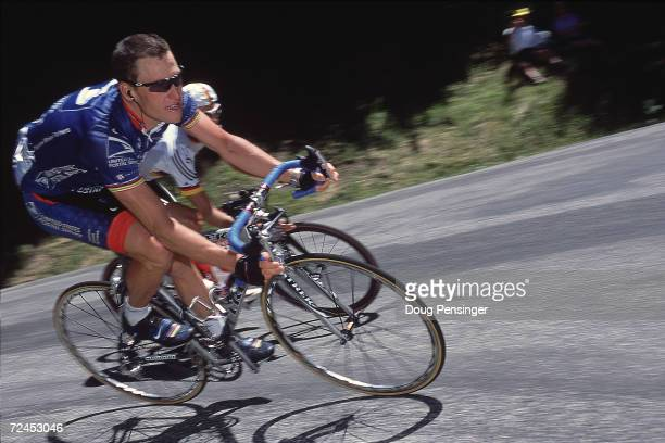 Lance Armstrong of the USA riding for the US Postal team is closely followed by Jan Ullrich of Germany during Stage 13 from Foix to SaintLarySoulan...