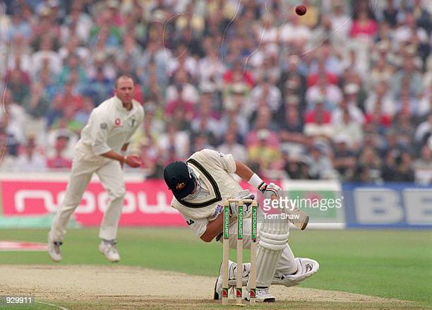 Mark Waugh of Australia ducks a bouncer from Craig White of England during the First Ashes Test match at Edgbaston in Birmingham England Australia...