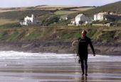 Matthew Hayden of Australia surfs in Croyde Bay England DIGITAL IMAGE Mandatory Credit Hamish Blair/ALLSPORT