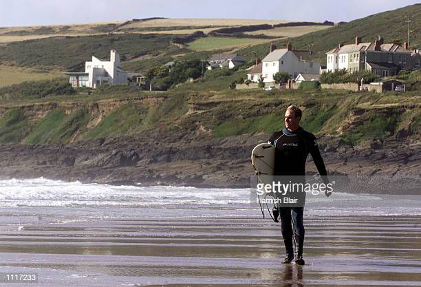 Matthew Hayden of Australia surfs in Croyde Bay England DIGITAL IMAGE Mandatory Credit Hamish Blair/ALLSPORT