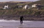 Matthew Hayden of Australia walks along the shoreline after surfing in Croyde Bay England DIGITAL IMAGE Mandatory Credit Hamish Blair/ALLSPORT