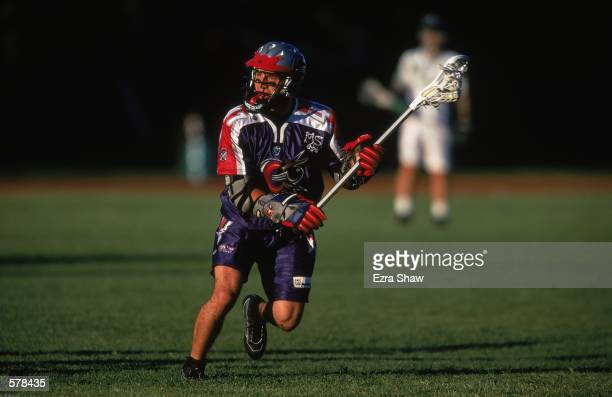 Mike Busza of the Boston Cannons runs on the field during the Major League Lacrosse game against the Long Island Lizards at Cawley Field in Hudson...
