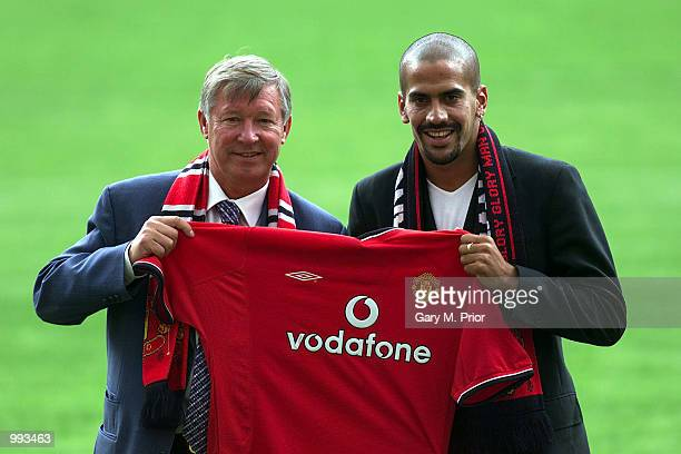 New Manchester United signing Juan Sebastien Veron is unveiled by Manager Sir Alex Ferguson at a press conference and photocall at Old Trafford...