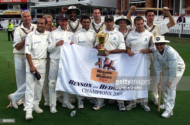 The Surrey team celebrate winning with the trophy after the BH Final between Gloucestershire and Surrey at Lords in London DIGITAL IMAGE Mandatory...