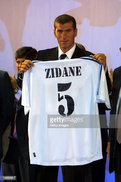 Zinedine Zidane of France poses with his new number 5 shirt during a press conference to announce his signing for Real Madrid from Juventus of Italy...