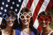 Local sports fans wear patriotic Olympic Rings sunglasses during the 1984 Olympic Games in Los Angeles California USA Mandatory Credit Allsport UK...