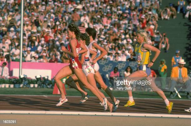 Mary Decker of the USA Zola Budd of Great Britain Wendy Sly of Great Britain and Maricica Puica of Romania in action during the 3000 Metres final at...