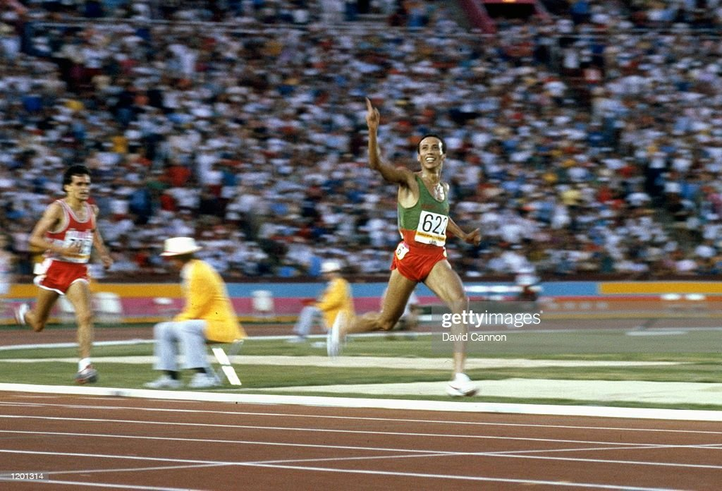 Said Aouita of Morocco waves to the crowd as he wins the 5000 metres final during the 1984 Olympic Games at the Coliseum Stadium in Los Angeles...