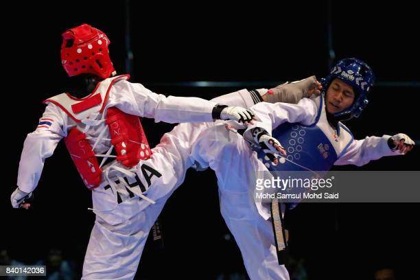 Julanan Khantikulanon of Thailand competes during the Taekwondo women's fin open under 46kg semifinals against Dhean Titania Fazrin of Indonesia as...