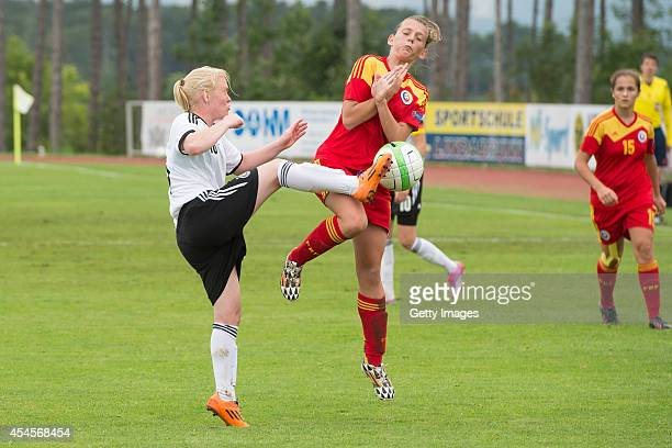 Jule Dallmann of Germany challenges Dariana Persida of Romania during the international friendly match between U17 Girl's Germany and U17 Girl's...
