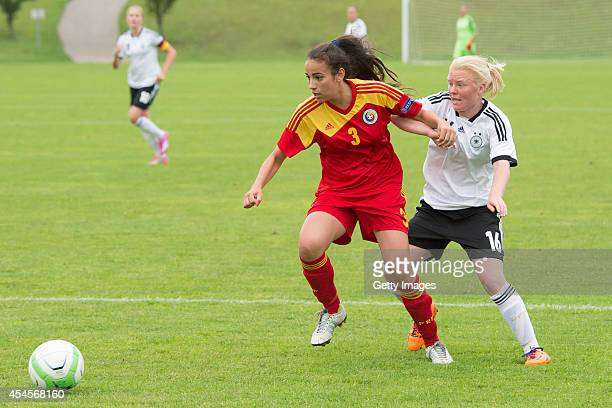 Jule Dallmann of Germany challenges Teodora Meluta of Romania during the international friendly match between U17 Girl's Germany and U17 Girl's...