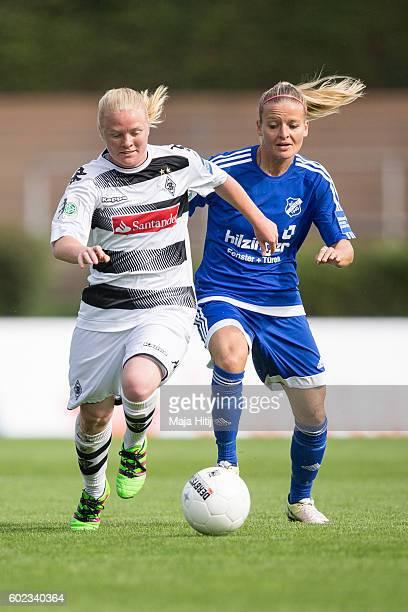 Jule Dallmann of VfL Borussia Moenchengladbach is challenged by Isabelle Meyer of SC Sand during the match of Allianz Frauen Bundesliga on September...