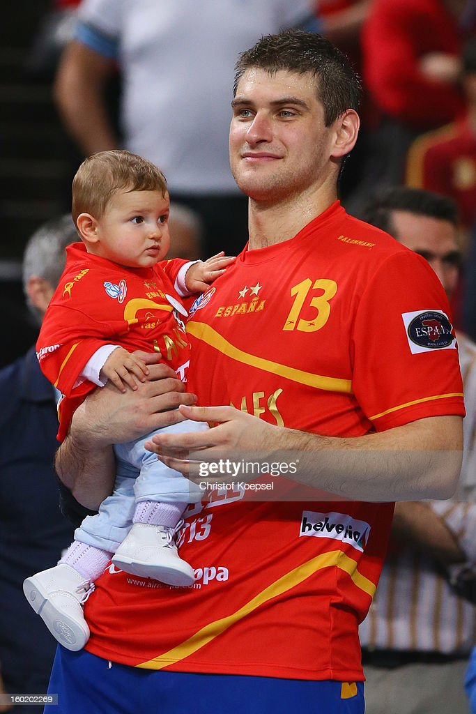 Julen Aguinagalde of Spain celebrate4s wit his baby prior to the podium after winning the Men's Handball World Championship 2013 final match between Spain and Denmark at Palau Sant Jordi on January 27, 2013 in Barcelona, Spain.