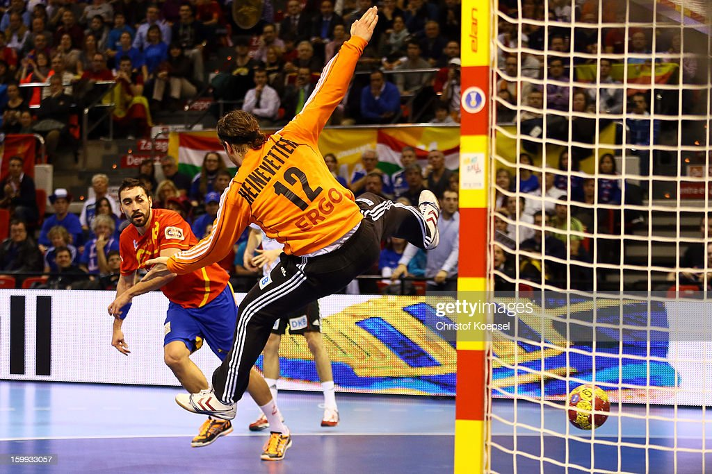 Julen Aguinagalde of Spain scores a goal <a gi-track='captionPersonalityLinkClicked' href=/galleries/search?phrase=Silvio+Heinevetter&family=editorial&specificpeople=640249 ng-click='$event.stopPropagation()'>Silvio Heinevetter</a> of Germany during the quarterfinal match between Spain and Germany at Pabellon Principe Felipe Arena on January 23, 2013 in Barcelona, Spain.