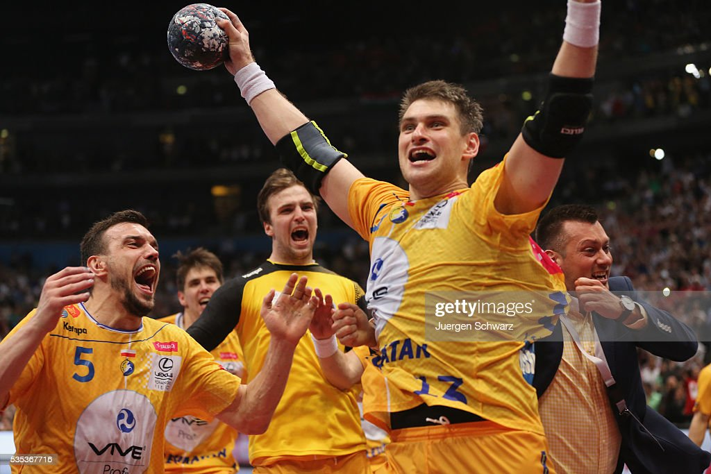 Julen Ahuinagalde Akizu of Kielce (R) celebrates after scoring the final penalty during the EHF Champions League Final against MKB Veszprem on May 29, 2016 in Cologne, Germany.