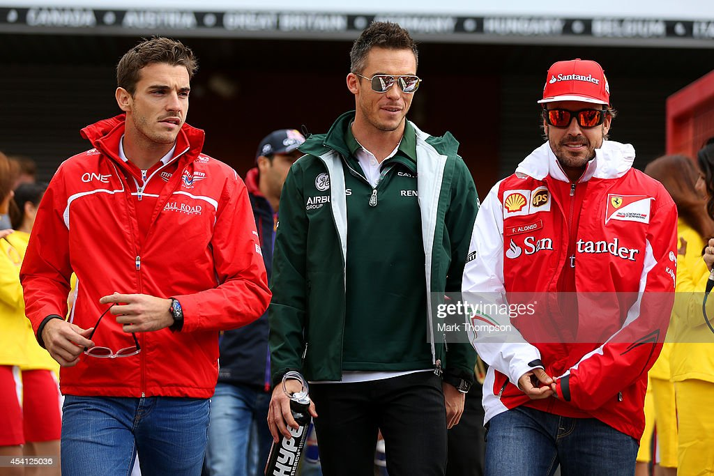 Jules Bianchi of France and Marussia, Andre Lotterer of Germany and Caterham and Fernando Alonso of Spain and Ferrari walk out for the drivers' parade before the Belgian Grand Prix at Circuit de Spa-Francorchamps on August 24, 2014 in Spa, Belgium.