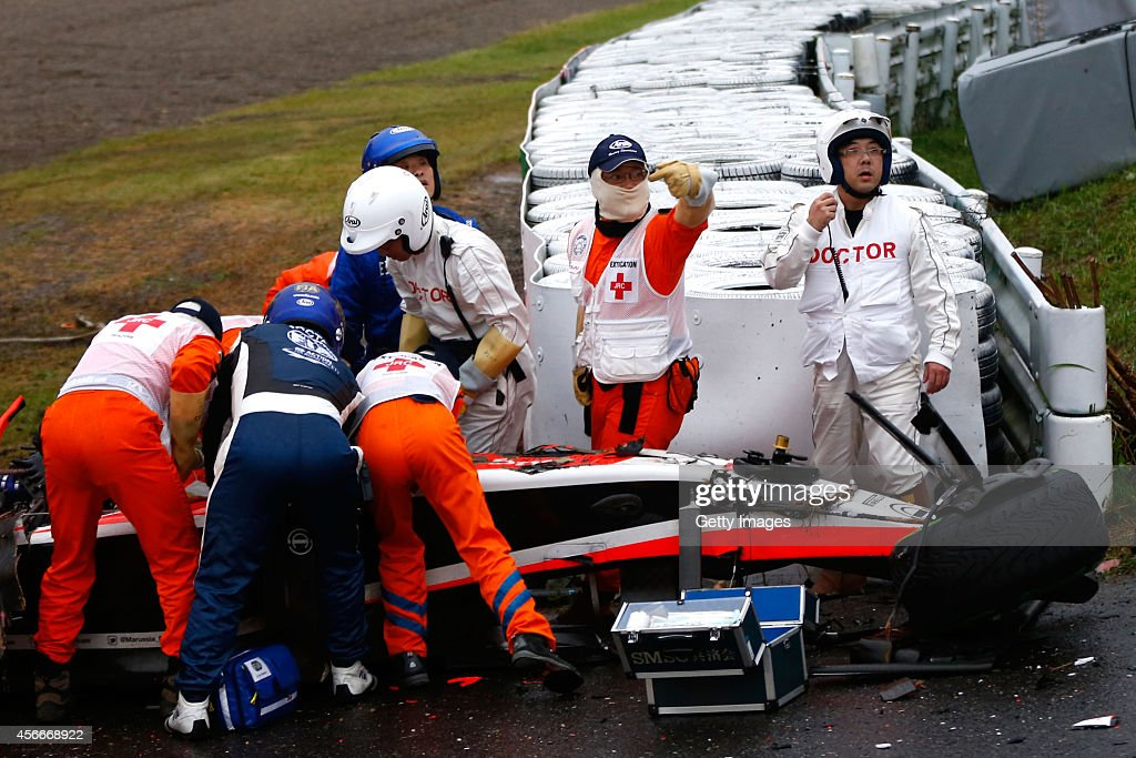 <a gi-track='captionPersonalityLinkClicked' href=/galleries/search?phrase=Jules+Bianchi&family=editorial&specificpeople=3942007 ng-click='$event.stopPropagation()'>Jules Bianchi</a> of France and Marussia receives urgent medical treatment after crashing during the Japanese Formula One Grand Prix at Suzuka Circuit on October 5, 2014 in Suzuka, Japan.