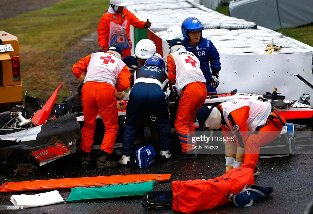 Jules Bianchi of France and Marussia receives urgent medical treatment after crashing during the Japanese Formula One Grand Prix at Suzuka Circuit on October 5, 2014 in Suzuka, Japan.