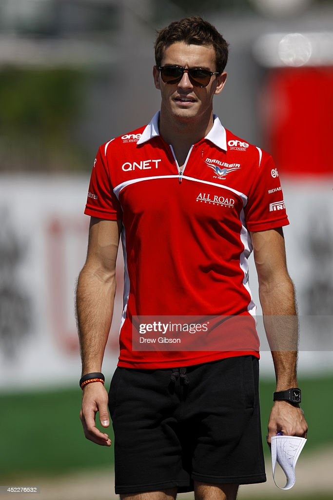 Jules Bianchi of France and Marussia walks along the track with members of his team during previews ahead of the German Grand Prix at Hockenheimring on July 17, 2014 in Hockenheim, Germany.