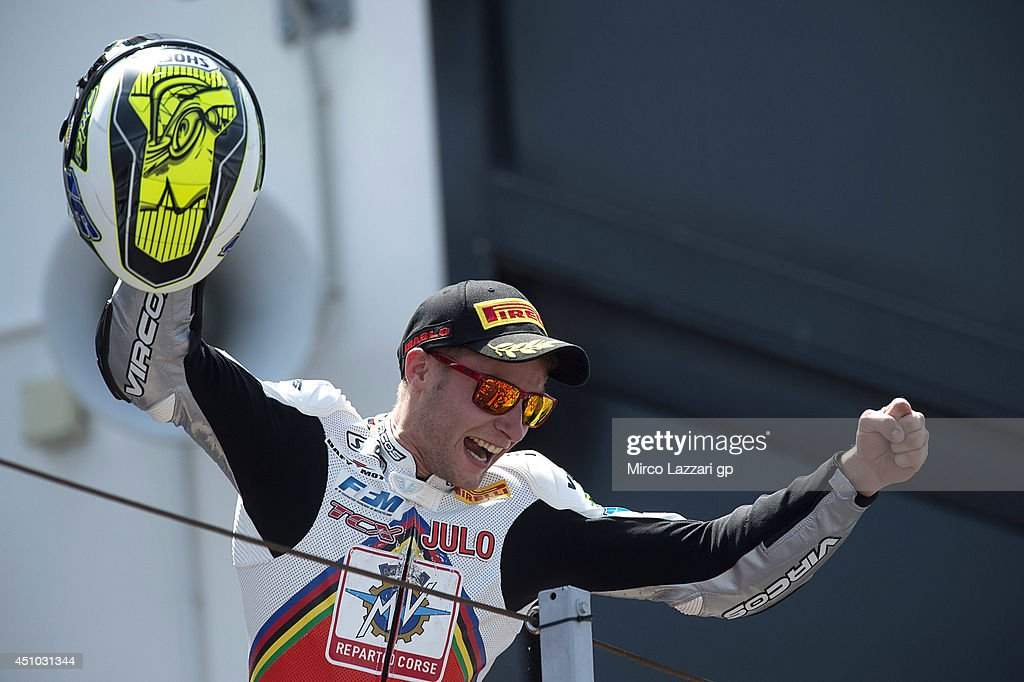 Jules Cluzel of France and MV Augusta RC-Yakhinich Motorsport celebrates the victory on the podium at the end of the Supersport race during the FIM Superbike World Championship - Race at Misano World Circuit on June 22, 2014 in Misano Adriatico, Italy.