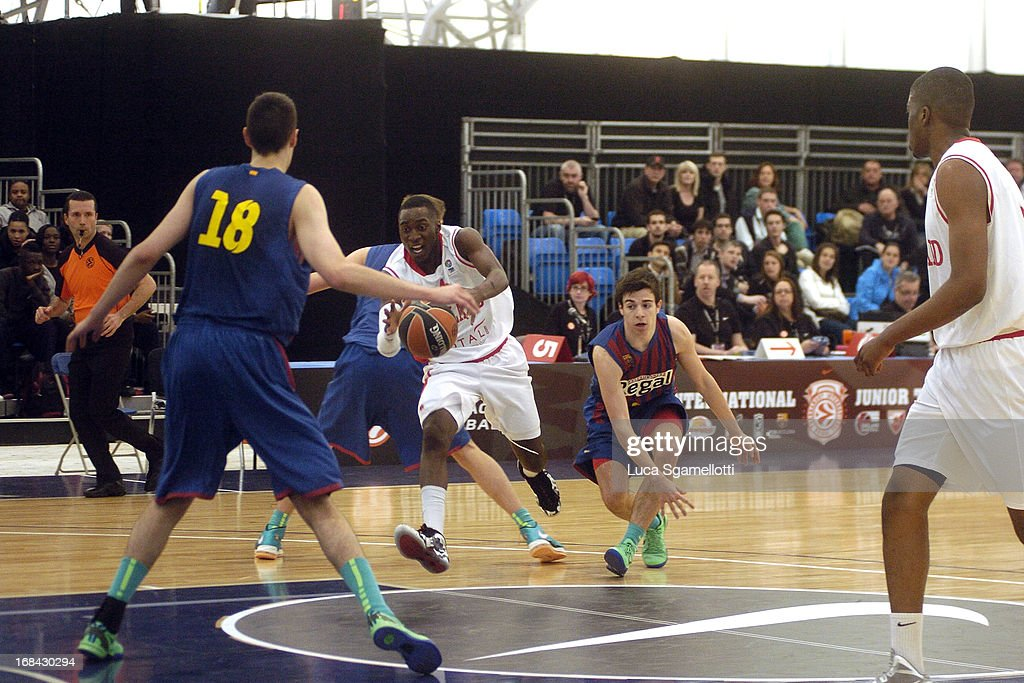 Jules Dang #4 of Team England drives upcourt during the Nike International Junior Tournament game between FC Barcelona Regal v Team England at London Soccerdome on May 9, 2013 in London, United Kingdom.