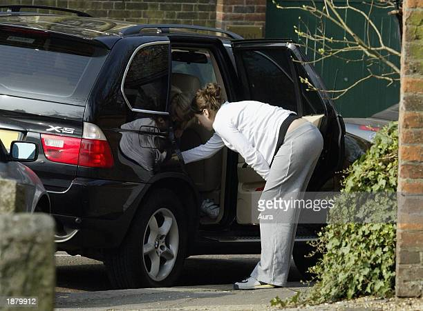 Jules Oliver wife of TV chef Jamie Oliver is seen attaching a baby seat to her car March 27 2003 in London Jules is currently pregnant with the...