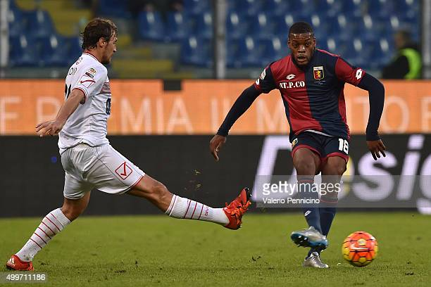 Jules Olivier Ntcham of Genoa CFC in action against Lorenzo Lollo of Carpi FC during the Serie A match between Genoa CFC and Carpi FC at Stadio Luigi...