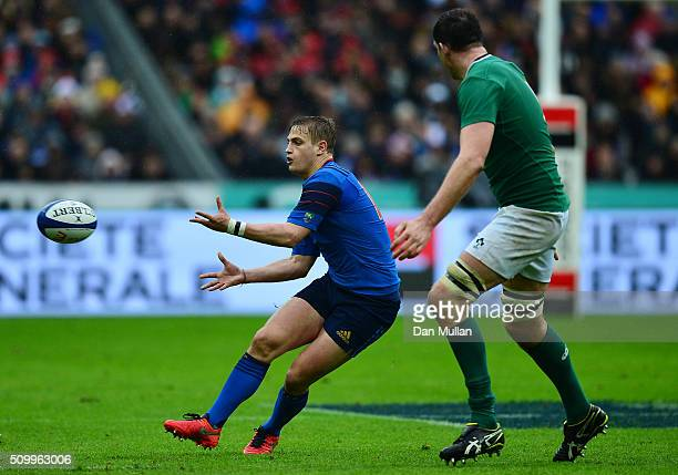 Jules Plisson of France passes as Devin Toner of Ireland closes in during the RBS Six Nations match between France and Ireland at the Stade de France...