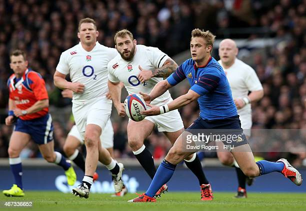 Jules Plisson of France passes the ball during the RBS Six Nations match between England and France at Twickenham Stadium on March 21 2015 in London...