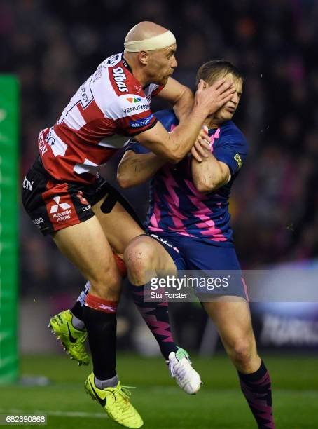 Jules Plisson of Stade Francais is hit with a high tackle from Willi Heinz of Gloucester during the European Rugby Challenge Cup Final between...