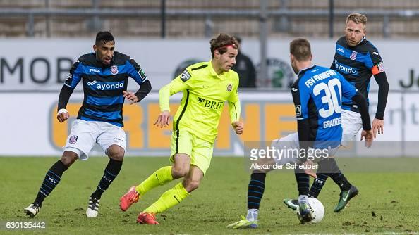 Jules Schwadorf of Wiesbaden challenges Fabian Graudenz of FSV Frankfurt during the Third League match between FSV Frankfurt and Wehen Wiesbaden at...