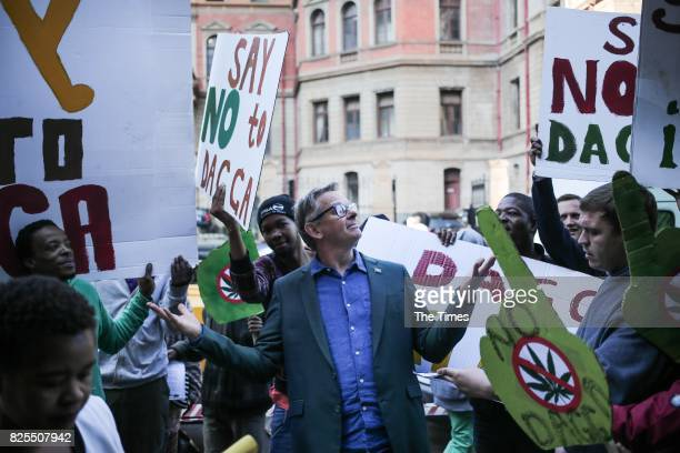 Jules Stobbs stands next to members of the Concerned Young People of SA outside the North Gauteng High Court on July 31 2017 in Pretoria South Africa...