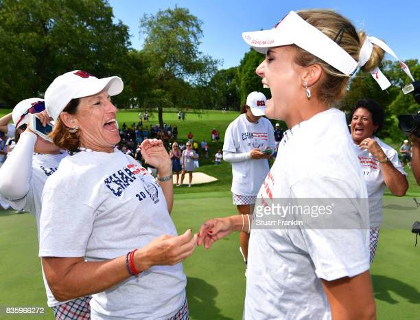 Juli Inkster Captain of Team USA celebrates with Lexi Thompson after the final day singles matches of The Solheim Cup at Des Moines Golf and Country...