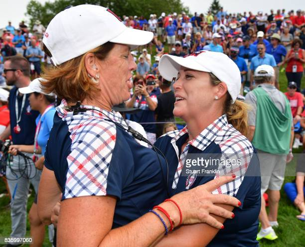 Juli Inkster celebrates with Cristie Kerr of Team USA after the final day singles matches of The Solheim Cup at Des Moines Golf and Country Club on...
