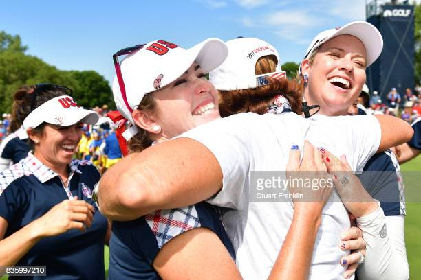 Juli Inkster celebrates with Paula Creamer and Brittany Lincicome of Team USA after the final day singles matches of The Solheim Cup at Des Moines...