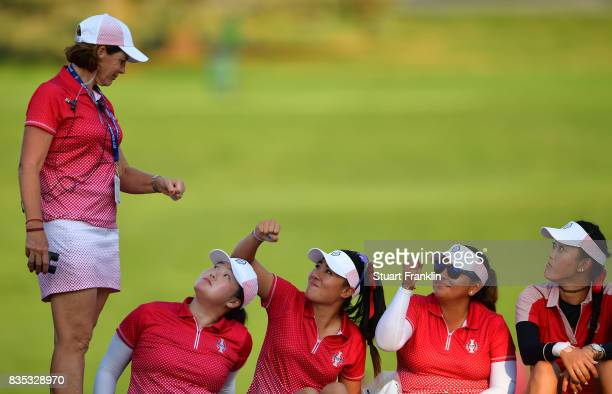 Juli Inkster Team USA Captain bumps fists with Danielle Kang as Angel Yin Lizette Salas and Michelle Wie look on during the afternoon fourball...