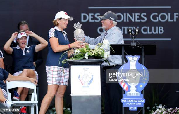 Juli Inkster the United States Team captain is presented with the Solheim Cup by John Solheim the Chairman and CEO of the Ping Company at the closing...