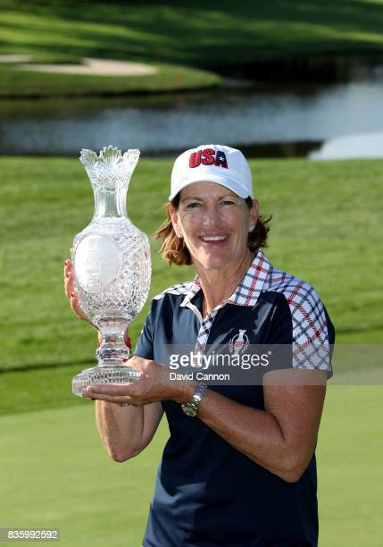 Juli Inkster the victorious United States Team captain holds the Solheim Cup after the closing ceremony after the final day singles matches in the...