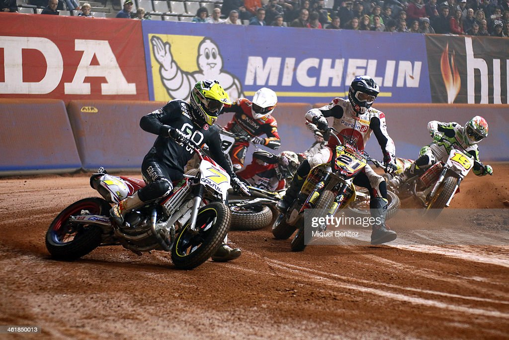 Juli Simon and Christian Iddon round the bend during the Superprestigio Dirt Track Race at the Palau of Sant Jordi on January 11, 2014 in Barcelona, Spain.