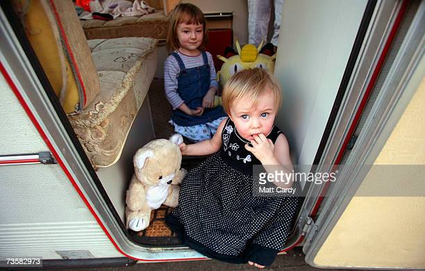 Julia 4 and her sister Shannon sit on their caravan step on the Clays Lane travellers site on March 15 2007 in London The residents of the site in...