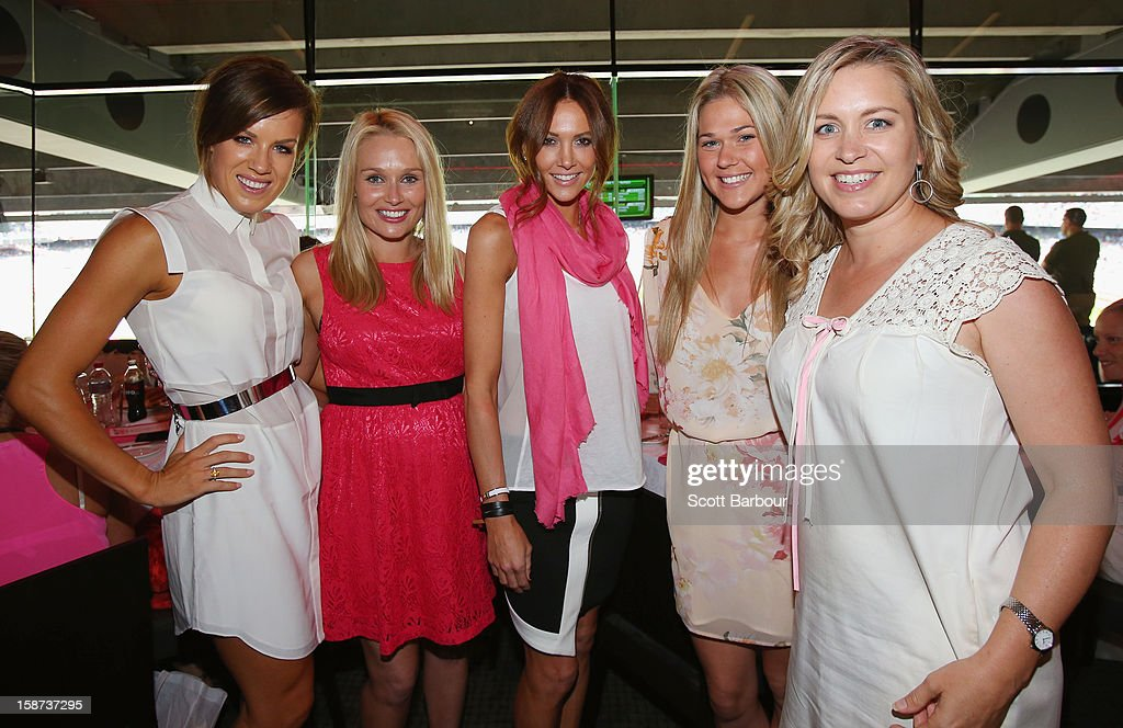 Julia Barry, partner of Matthew Wade of Australia, Lee Furlong, wife of Shane Watson, Kyly Clarke, wife of Michael Clarke of Australia, Sam Williams, partner of David Warner of Australia and Virginia Lette, wife of Ed Cowan of Australia pose during the 'High Tea at the G' luncheon on day two of the International Test match between Australia and Sri Lanka at Melbourne Cricket Ground on December 27, 2012 in Melbourne, Australia.