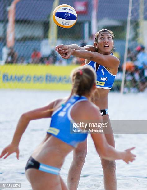 Julia Benet of Argentina competes in the main draw match against Switzerland at Pajucara beach during day three of the FIVB Beach Volleyball World...