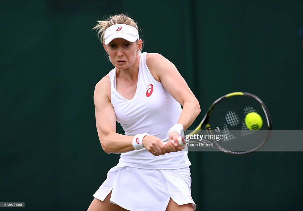 Julia Boserup of the United States plays a backhand during the Ladies Singles first round match against Tatjana Maria of Germany on day three of the Wimbledon Lawn Tennis Championships at the All England Lawn Tennis and Croquet Club on June 29, 2016 in London, England.