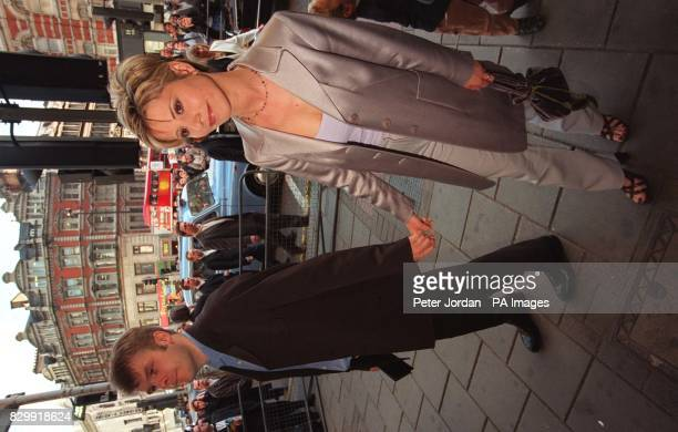 Julia Carling the former wife of England rugby star Will Carling and her boyfriend Rob Stringer arriving at London's Dominion Theatre this evening...